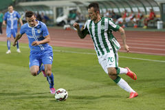 Ferencvarosi TC vs. HNK Rijeka UEFA EL football match. BUDAPEST, HUNGARY - JULY 24, 2014: Duel between Roland Ugrai of FTC (r) and Ivan Tomecak of Rijeka during royalty free stock photos