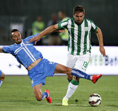Ferencvarosi TC vs. HNK Rijeka UEFA EL football match. BUDAPEST, HUNGARY - JULY 24, 2014: Marin Leovac of Rijeka commits a foul against Daniel Bode of FTC (r) stock photos