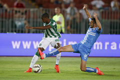 Ferencvarosi TC vs. HNK Rijeka UEFA EL football match. BUDAPEST, HUNGARY - JULY 24, 2014: Marin Leovac of Rijeka slides against Somalia of FTC (l) during stock photos