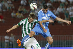 Ferencvarosi TC vs. HNK Rijeka UEFA EL football match. BUDAPEST, HUNGARY - JULY 24, 2014: Next to Michal Nalepa of FTC (l) heads a goal Miral Samardzic of Rijeka stock photography