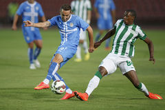 Ferencvarosi TC vs. HNK Rijeka UEFA EL football match. BUDAPEST, HUNGARY - JULY 24, 2014: Somalia of FTC (r) commits a foul against Marin Leovac of Rijeka during stock image