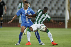 Ferencvarosi TC vs. HNK Rijeka UEFA EL football match. BUDAPEST, HUNGARY - JULY 24, 2014: Somalia of FTC (r) covers the ball from Josip Brezovec of Rijeka during stock image