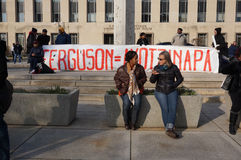 Ferguson Equals Ayotzinapa. Photo of protesters downtown at pennsylvania avenue in washington dc on 12/13/14.  These people are taking a break in front of sign Royalty Free Stock Images