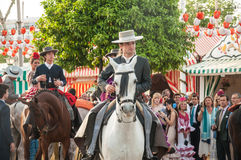 Feria de Abril. Is the Celebration of Spring in Sevilla, Spain. During this fiesta people wear traditional clothes and dresses of Andalusia and dance the local stock images