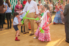 Feria de Abril. Is the Celebration of Spring in Sevilla, Spain. During this fiesta people wear traditional clothes and dresses of Andalusia and dance the local royalty free stock image