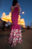 Feria de Abril. Woman in motion in tipycal dress dyiuring Feria de Abril, Seville, Spain royalty free stock photos