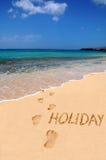 Feriado da palavra na praia Imagens de Stock Royalty Free