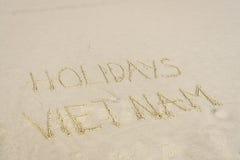 Feriados Vietname escrito na areia Fotografia de Stock Royalty Free