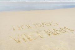 Feriados Vietname escrito na areia Foto de Stock