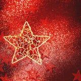 Feriebakgrund med den guld- stjärnan Arkivfoto