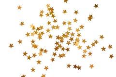 Feriebakgrund med små guld- stjärnor Fotografering för Bildbyråer