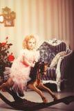 Feriekort i tappningstil Liten prinsessa som rider hors för en leksak Fotografering för Bildbyråer