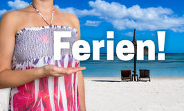 Ferien (in german Holiday) concept is presented by woman on the Stock Image