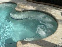 Ferien-Rücksortierung-Jacuzzi-Pool Stockbilder