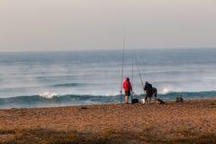 Ferier för strand för soluppgång för fiskarebränningvågor Royaltyfri Fotografi