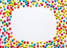 Ferieram av mångfärgade söta godisdragees royaltyfri fotografi