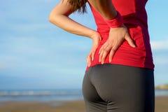 Ferimento da dor nas costas do corredor mais baixo Imagens de Stock Royalty Free