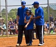 Ferimento do softball da menina Imagem de Stock