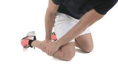 Ferimento físico running, dor de músculo do pé no estúdio imagens de stock