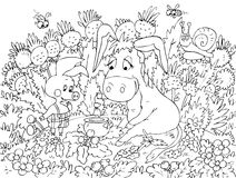 Ferkel und Esel, die auf dem Rasen sitzen Stockfotografie