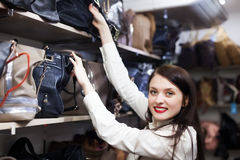 Fermale customer choosing leather bag Royalty Free Stock Photo