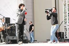 Ferman performs live. MANGA rock group perform live on the stage at Marmara Egitim Koyu, Maltepe. April 25, 2010 in Istanbul, Turkey Stock Photography