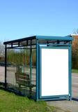 Fermata dell'autobus con il bilboard in bianco Fotografie Stock