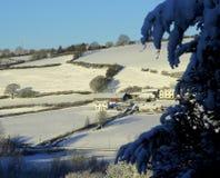 Ferme d'hiver, cadre neigeux Photos stock