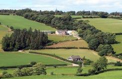 Ferme de colline, avec des maisons Images stock
