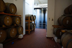 Fermentation tanks and barrels of wine in cellar in Santorini. Stock Photo