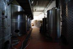 Fermentation tanks and barrels of wine in cellar in Santorini. Stock Photo