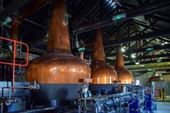 Fermentation tanks for making different types of whiskey in the Distillery stock images