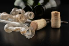 Fermentation tube and corkscrew on a black table. Accessories needed to prepare homemade wine. Dark background bottle glass alcohol alcoholic bar cabernet card stock photo