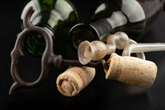 Fermentation tube and corkscrew on a black table. Accessories needed to prepare homemade wine. Dark background bottle glass alcohol alcoholic bar cabernet card royalty free stock photo