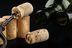 Fermentation tube and corkscrew on a black table. Accessories needed to prepare homemade wine. Dark background bottle glass alcohol alcoholic bar cabernet card stock photos