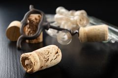 Fermentation tube and corkscrew on a black table. Accessories needed to prepare homemade wine. Dark background bottle glass alcohol alcoholic bar cabernet card royalty free stock image