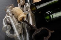 Fermentation tube and corkscrew on a black table. Accessories needed to prepare homemade wine. Dark background bottle glass alcohol alcoholic bar cabernet card royalty free stock images