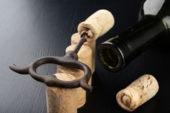 Fermentation tube and corkscrew on a black table. Accessories needed to prepare homemade wine. Dark background bottle glass alcohol alcoholic bar cabernet card royalty free stock photos