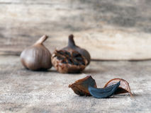 Fermented black garlic bulbs and cloves. Black garlic caused by a fermentation process of several weeks Stock Photography