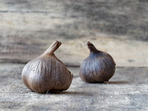 Fermented black garlic bulbs. Black garlic which is caused by a fermentation process of several weeks Royalty Free Stock Photos