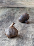 Fermented black garlic bulbs. Black garlic which is caused by a fermentation process of several weeks Stock Image
