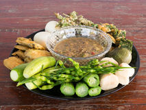 Fermented fish spicy dip with boiled eggs and vegetables. Wood  background Royalty Free Stock Photos