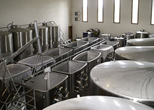Fermenting tanks in a Napa winery. The fermenting room in a winery in the Napa Valley,California Stock Photos
