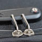 Fermez à clef avec des nombres sur la tirette de valise Image libre de droits