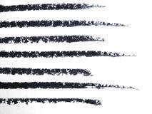 Fermez-vous d'un dessin au crayon d'eye-liner Images stock