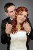Fermez-vous d'un jeune couple gentil de mariage Image stock