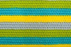 Fermez-vous d'un morceau de crochet coloré image stock