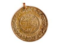 fermez-vous d'une pièce de monnaie antique de tabouret Photos stock