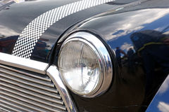 Fermez-vous de l'image courante automobile de vintage de Mini Cooper Photographie stock libre de droits
