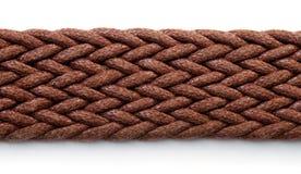Fermez-vous de la ceinture tissée brune de textile photos libres de droits
